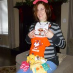"For Baby Querubin, ""Allana Georgiana"", there's the toboggan, mittens, bib with ""Cool Like Auntie"" on it, Clemson Tigers t-shirt, duckie toy, giraffe safety blankie, and knitted booties.  Need to be prepared for the Cleveland winter!"